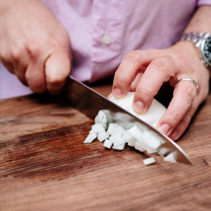The Taste SF shows you how to cut an onion by finishing a dicing demonstration with step-by-step images