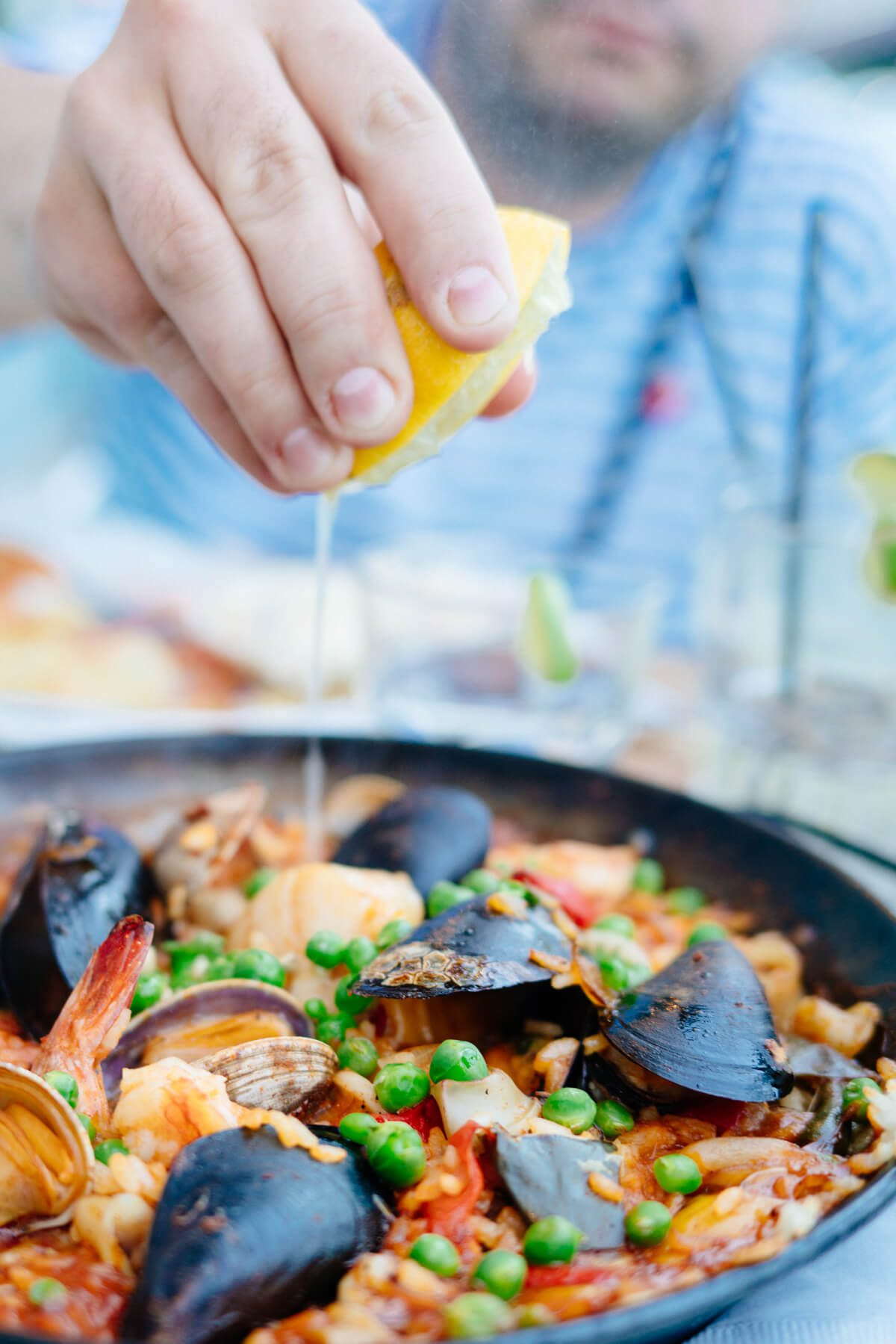 Clayton from The Taste SF Squeezing Lemon on Paella at Sam's Chowder House in Half Moon Bay