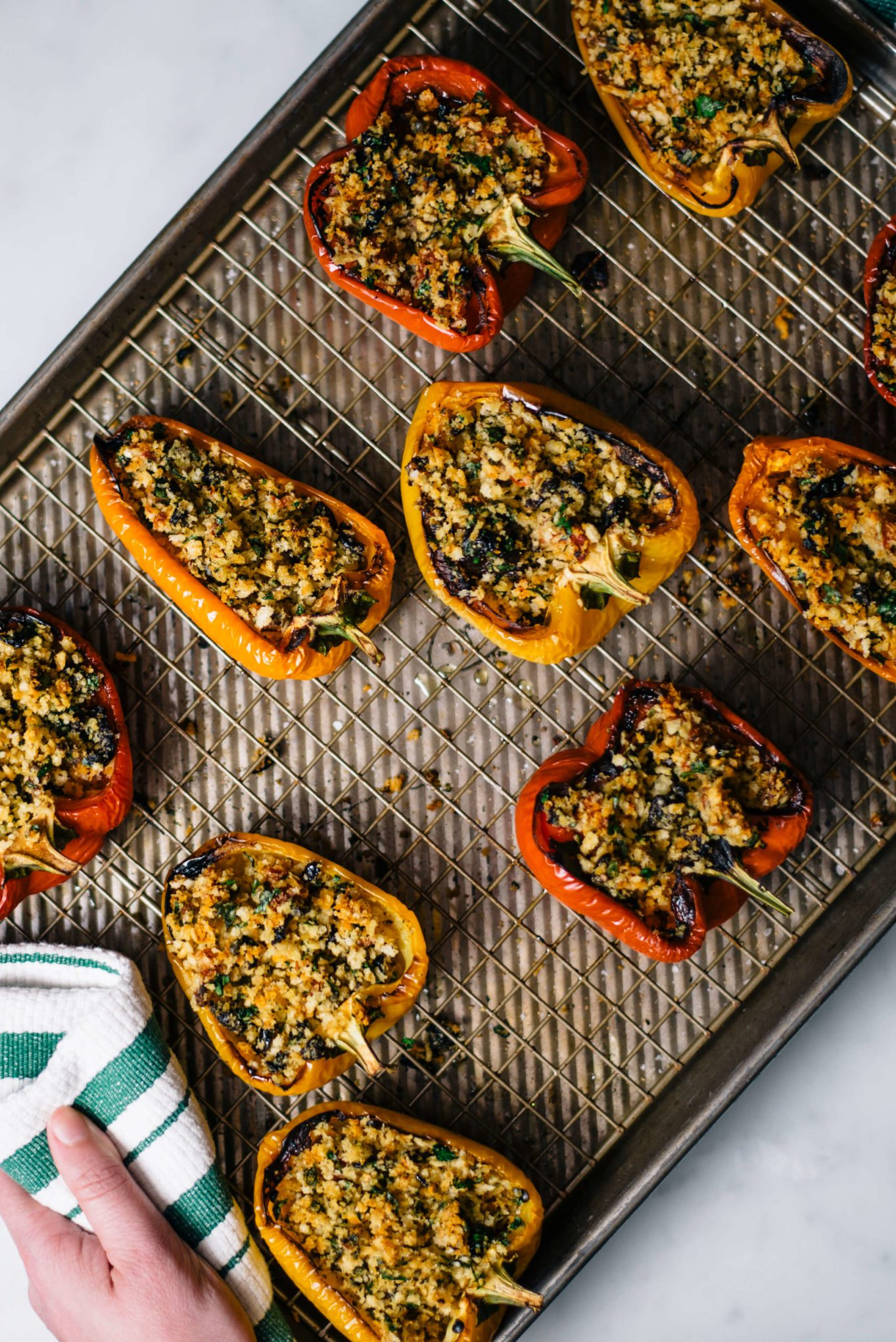 Baking these easy Italian stuffed peppers for a simple weeknight meal made with olives and anchovies by The Taste SF