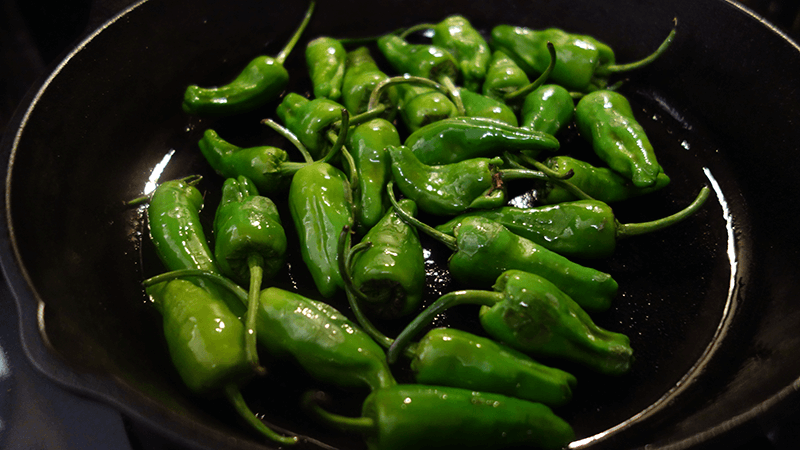 padrones cooking in cast iron