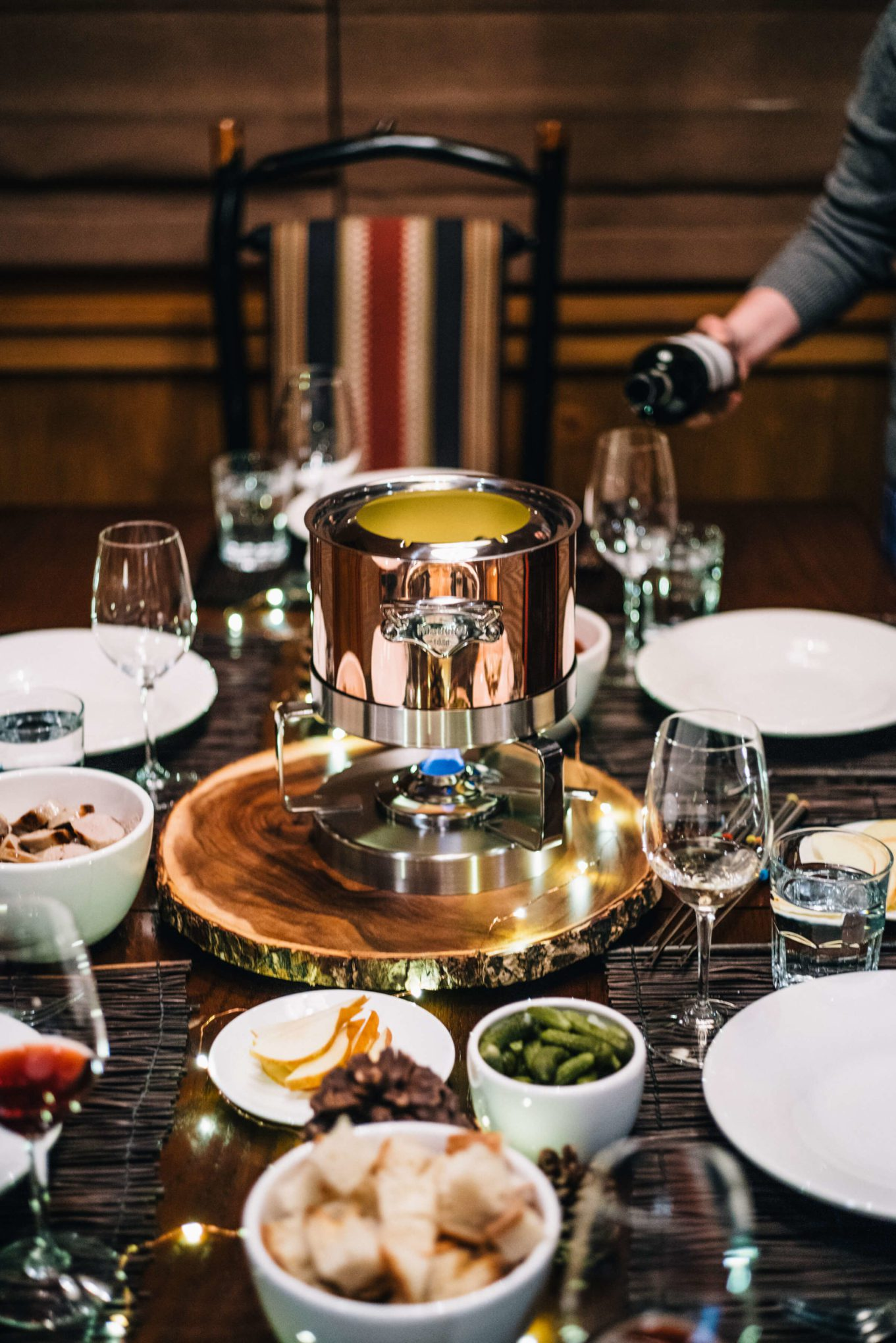 Setting the table and pouring wine Fondue Party with Mauviel on the taste edit in tahoe
