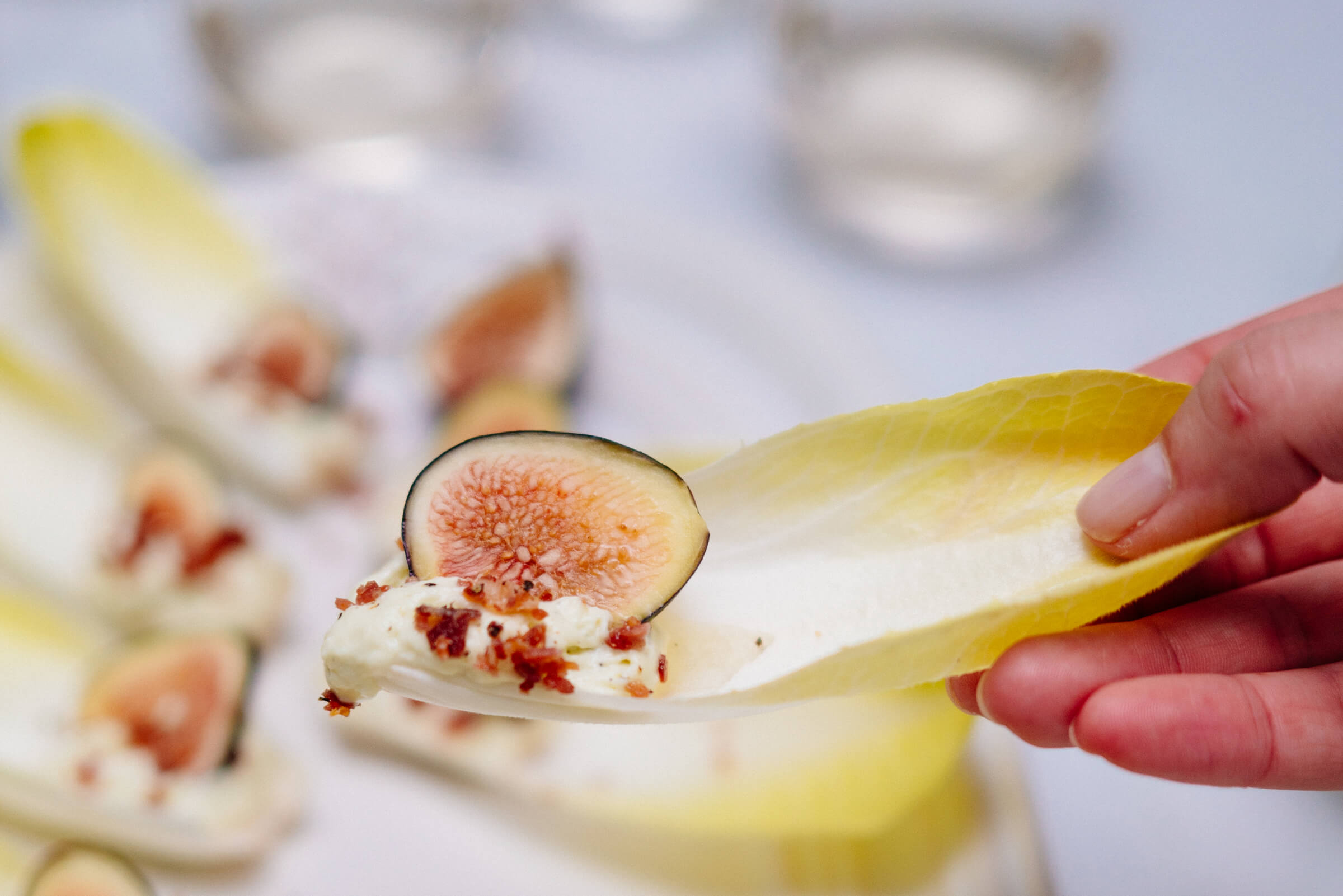 The Taste SF's endive chips with figs and crispy prosciutto di parma and blue cheese espuma is a perfect starter