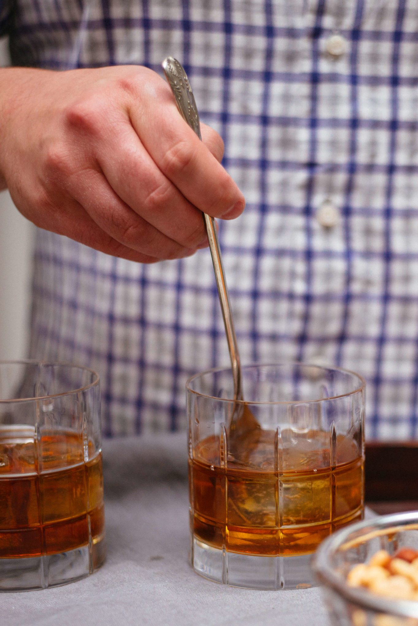 This simple fall cocktail is stored using a vintage spoon