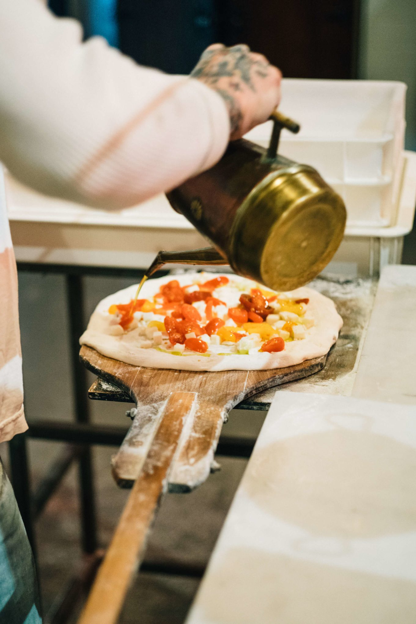 Anthony Mangieri adding olive oil while Making Neapolitan Pizzas Una Pizza Napoletana in in San Francisco with The Taste SF