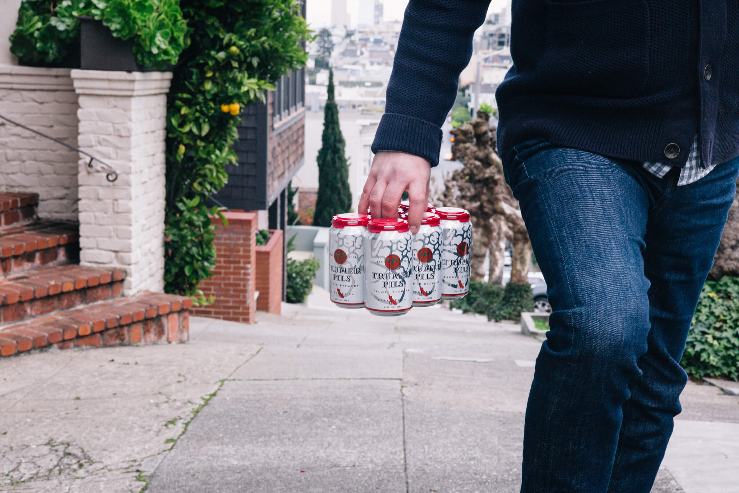 The Taste Edit carrying Trumer Pils Cans in San Francisco