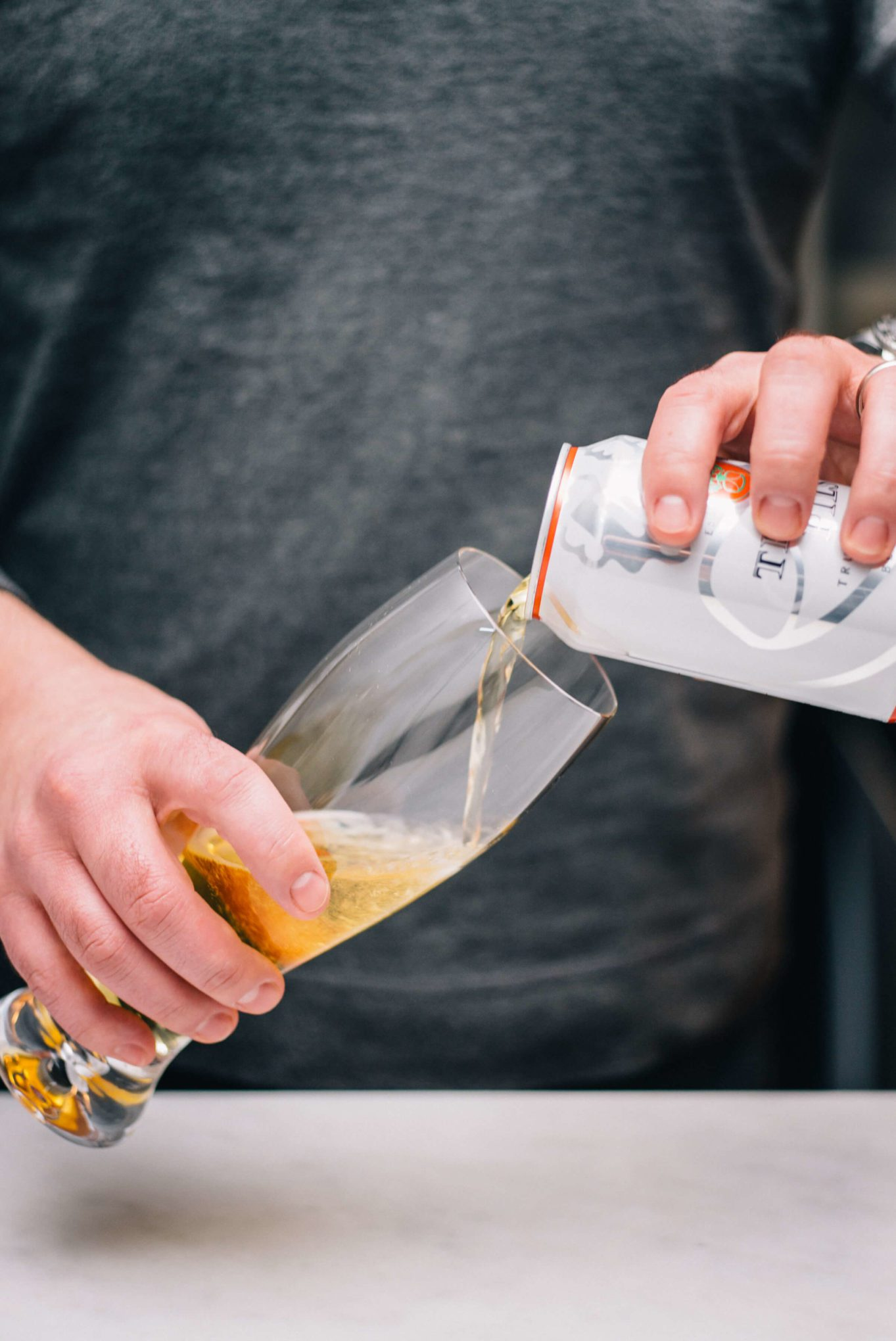 The Taste Edit pouring Trumer Pils Beer from a Can in San Francisco