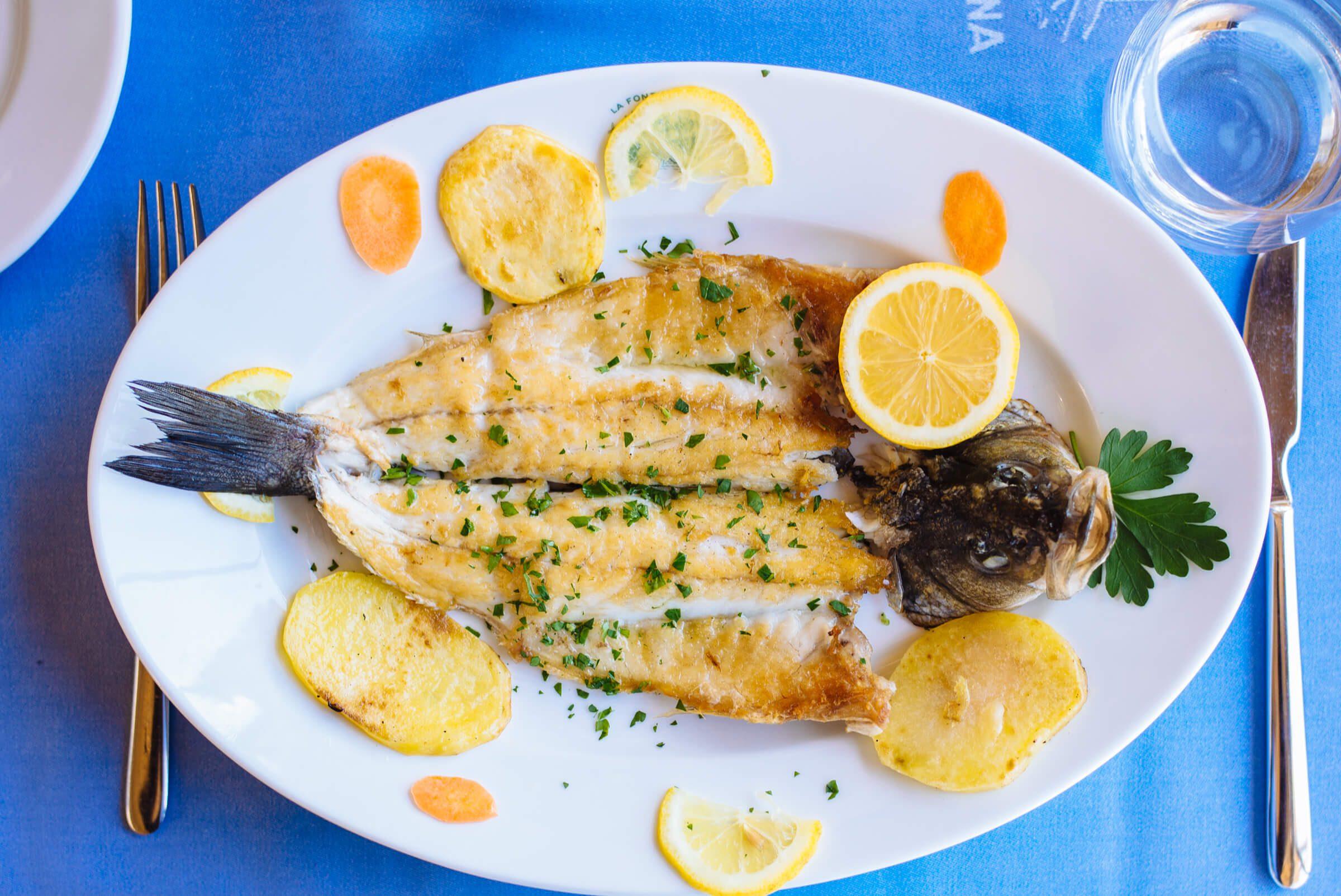 Order local fish dishes and take a boat directly to Ristorante La Fontelina in Capri, Italy, The Taste Edit