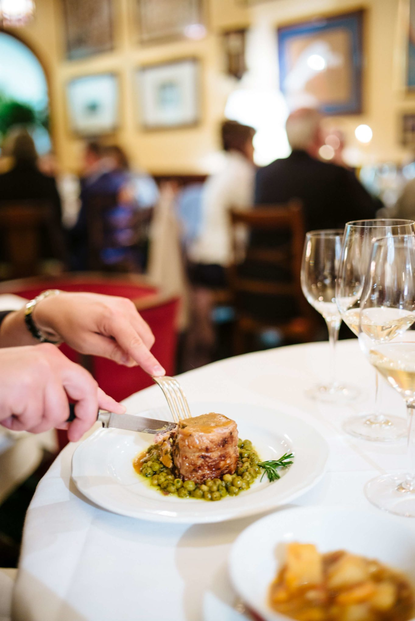 roasted leg of lamb, off the bone, and rolled with artichoke, sage, rosemary, garlic and black pepper, served with green peas and prosciutto at Ristorante Cibreo in Florence, The Taste Edit