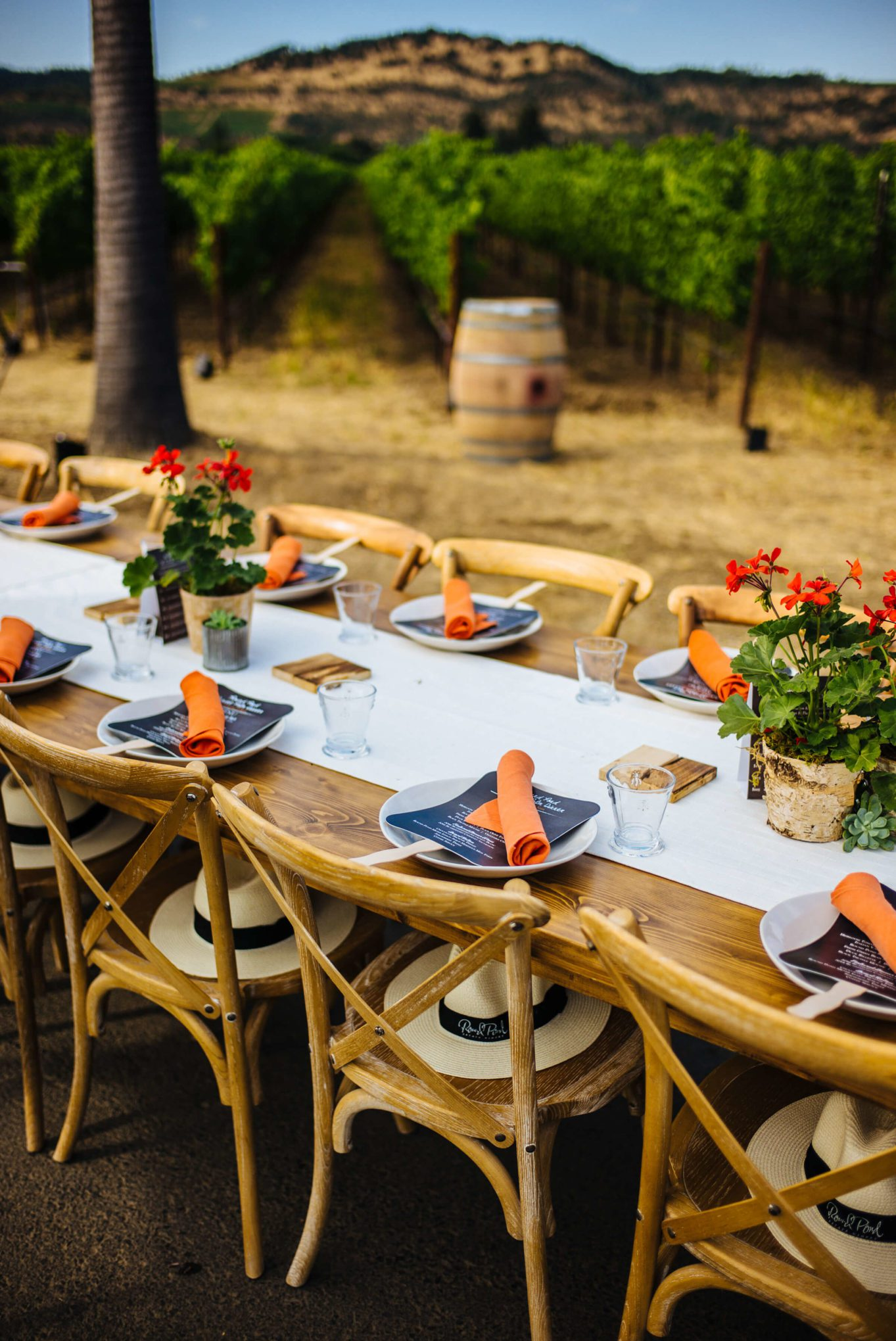 Setting the table at Round Pond Estate Sunset Palm Dinner in Napa, The Taste Edit