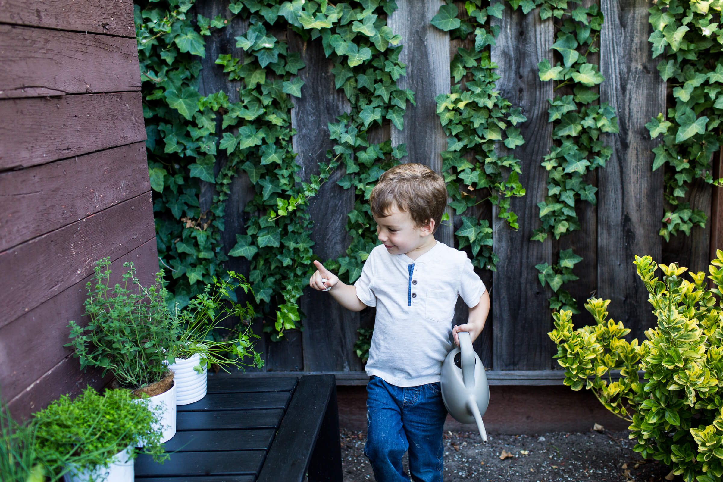 Sam helping to water his Herb Garden, teaching children about food and herbs with Elise from The Curiosity Project, The Taste Edit