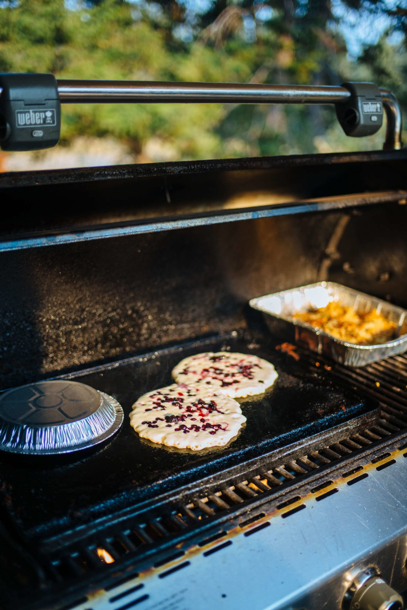 Making Huckleberry Pancakes on the grill while glamping at The Resort at Paws Up in Montana, The Taste Edit