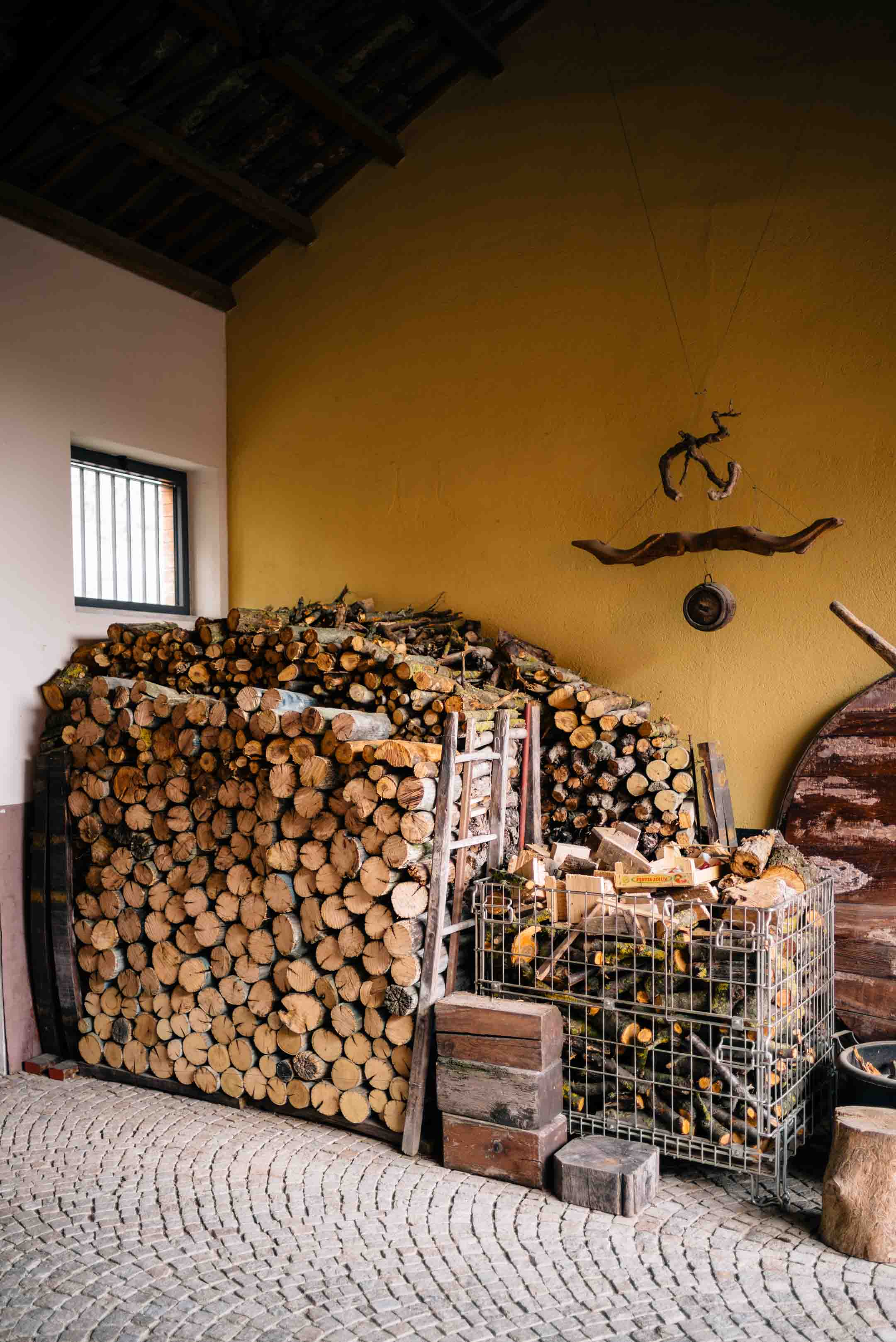 Firewood at legendary winery Bartolo Mascarello in Piedmont, one of the best wineries in piedmont, see The Taste SF's visit.