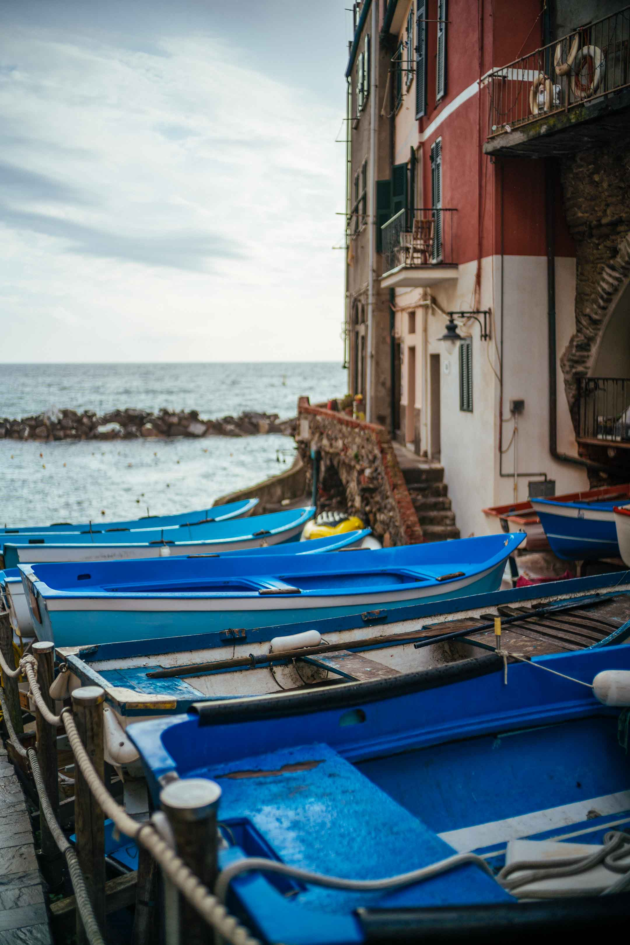 Boats along the shore at Ramagore in Cinque Terre, one of the most popular vacation destinations in Italy. Rent a boat to ride along the coast and see the town. Take a boat tour of Cinque Terre.