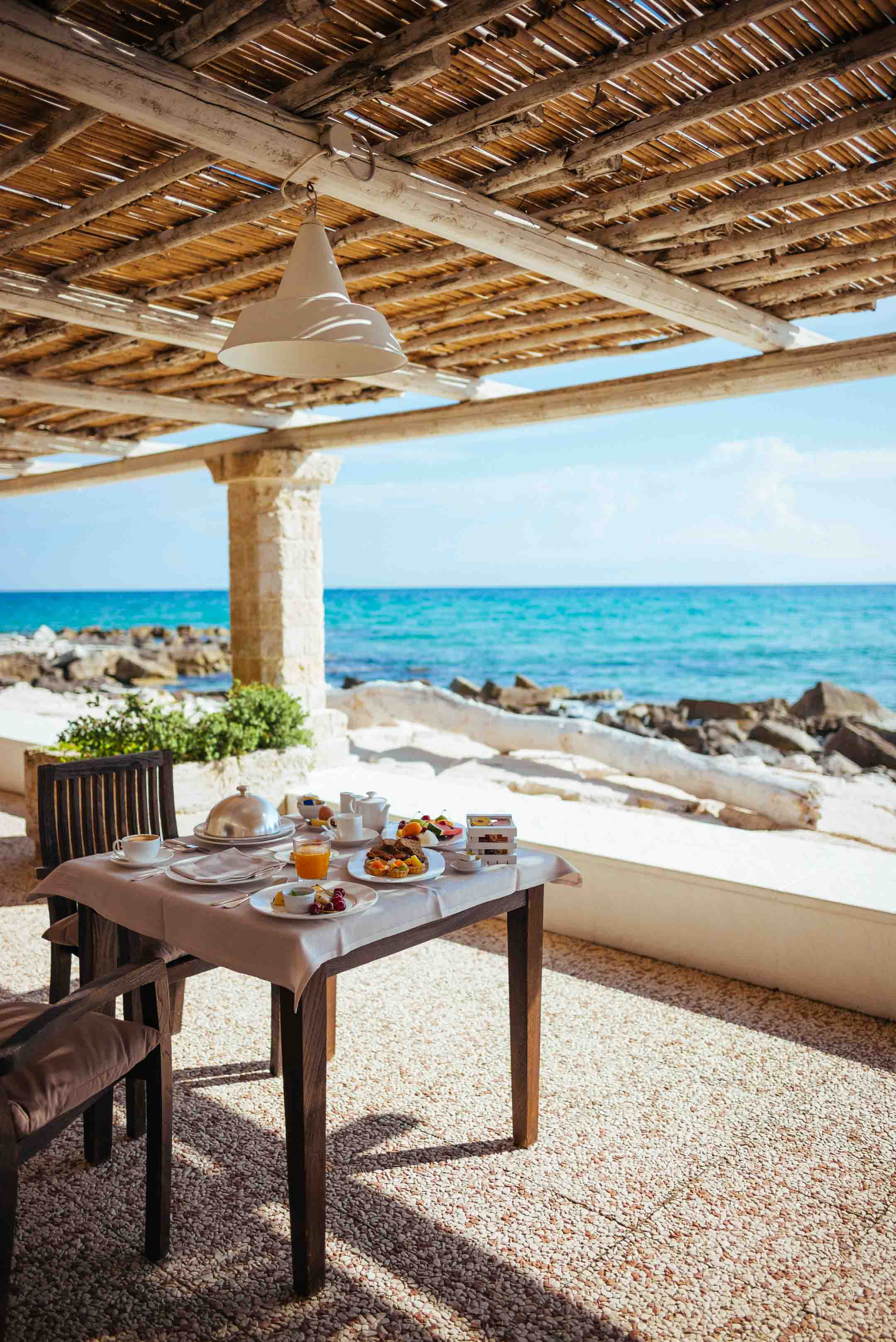 Custom breakfast is served each morning to your patio overlooking the ocean in this luxury Puglia hotel La Peschiera south of Monopoli, Italy, The Taste Edit