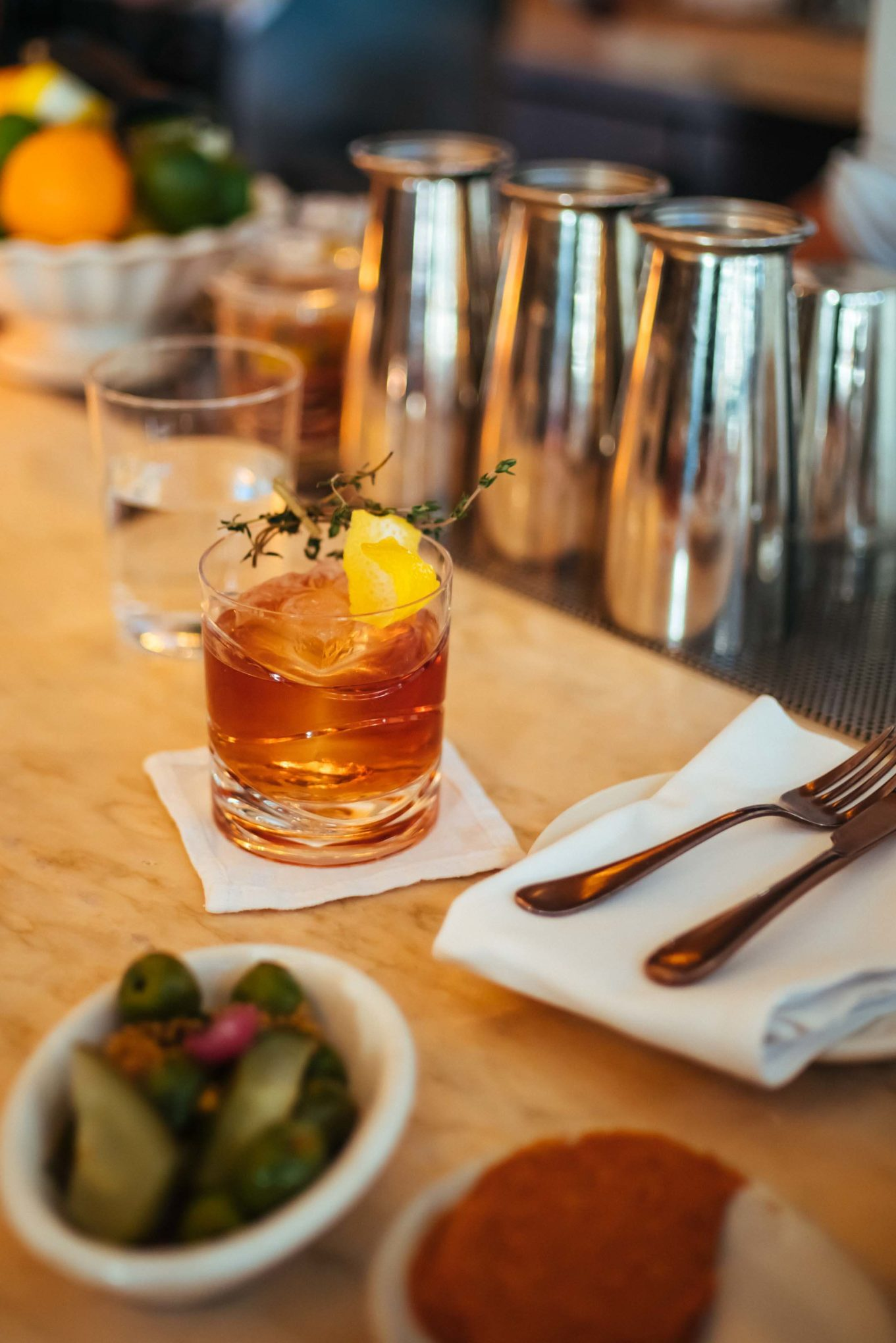 "The Taste Edit recommends for the best cocktails in Hollywood visit Chef Curtis Stone's Gwen in Los Angeles. For a twist on a Negroni, try the ""Negroni Reflection"" made with Sloe Gin, Salers aperitif, thyme, amara, and raspberry"