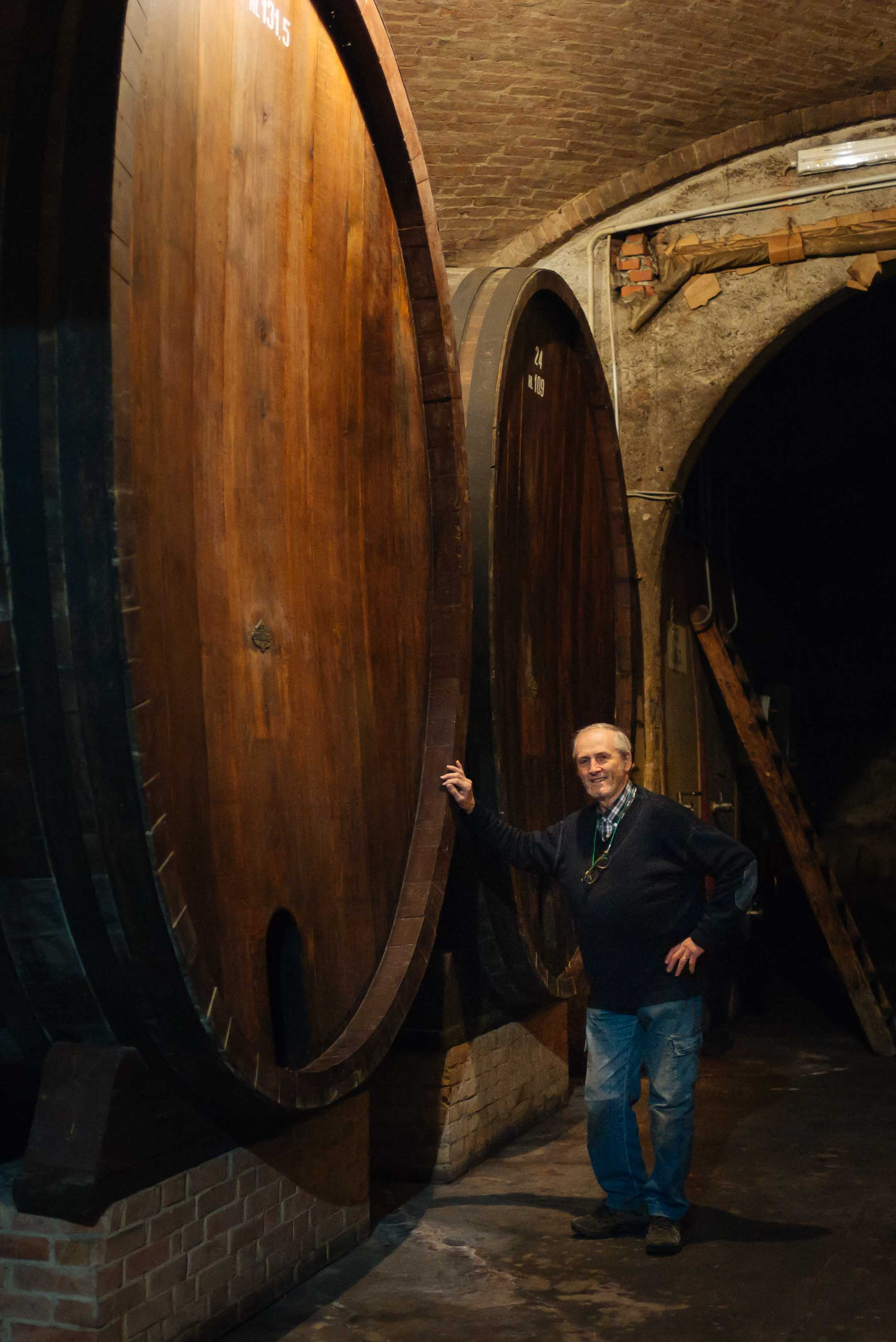 Winemaker Mauro Mascarello at Giuseppe Mascarello winery in Barolo Piedmont Italy with the historic barrels his grandfather had custom made for the winery