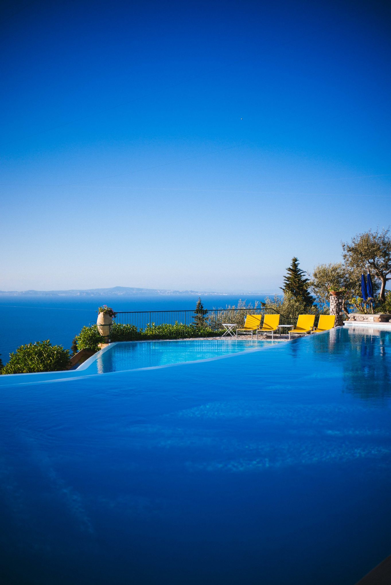 Relax by a double infinity pool at Hotel Caesar Augustus Capri Italy on your Amalfi Coast vacation, The Taste SF