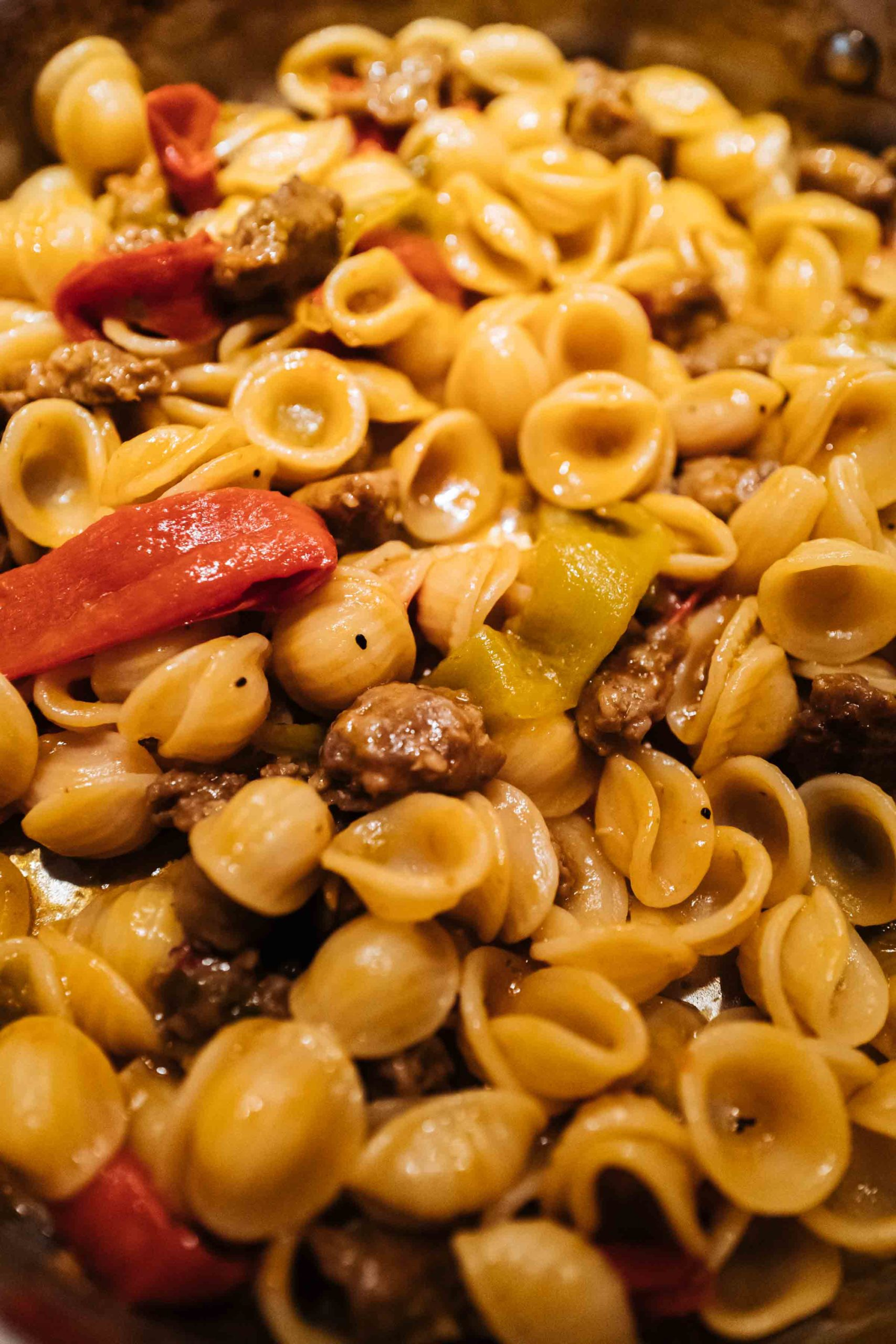 Make this easy Italian Sausage and Pepper Orecchiette Pasta recipe. It's a quick dinner made with orecchiette pasta, garlic, onions, and tomato paste from TheTasteEdit.com #recipe #sausage #pasta