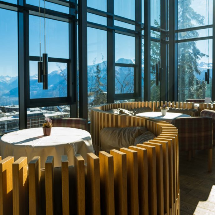 Swirl wood chairs with views from breakfast at the Crans Ambassador Hotel in Crans Montana, Switzerland. By The Taste Edit #views #hotel
