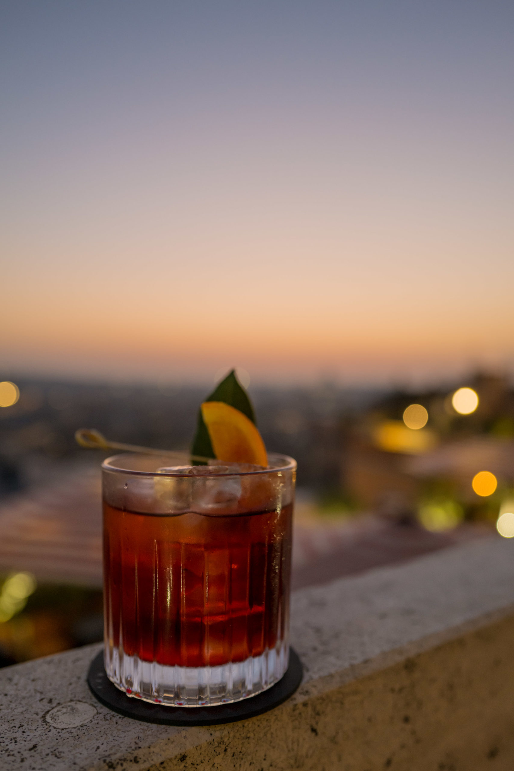 Order a Cielo Negroni at sunset on the rooftop terrace Rocco Forte's Hotel de la Ville Rome - The Taste Edit #rome #hotel #negroni #travel