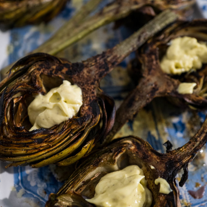 Fill the cups of grilled artichokes for dipping. It's perfect for parties, The Taste Edit #artichokes #recipes #grilling